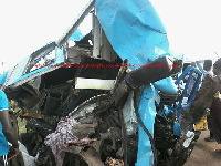 A tipper truck loaded with gravels crushed into a 207 Benz bus
