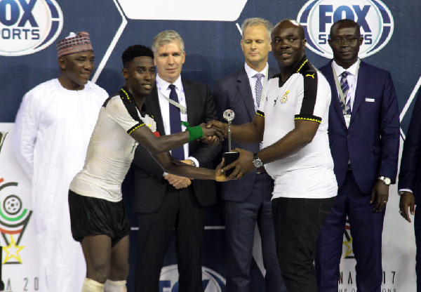 Isaac Twum receiving an award for being the overall Best Player in the WAFU tournament