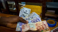 The Cedi traded against the dollar is at a mid-rate of 5.8623