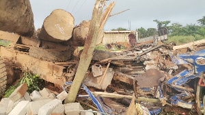 According to eyewitnesses, the timber logs fell from the moving truck and crushed the cargo car