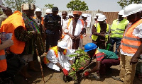 Planting a tree to signify the beginning of the project