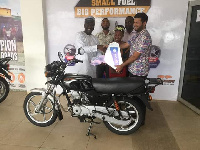 organizers receive the motorbike ahead of the Ramadan Cup