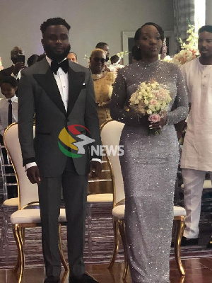 Kofi Mills, son of the late President Atta Mills, with his wife