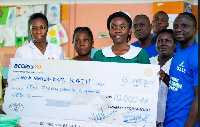 The Awake team presenting a chegue of GHC10,000 to nurses at the KATH as bills for the mothers
