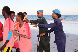 Somali police officers disperse people from the Lido beach in Mogadishu, Somalia,| ABDIRAZAK HUSSEIN