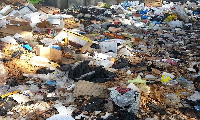 file photo: Residents often dump their waste into open spaces, drains and rivers