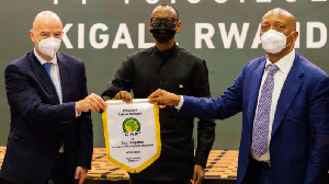 CAF executives in the photograph with Rwanda's president