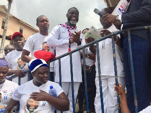Annor Mensah flanked by some supporters at the party premises