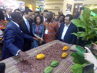 Dr Afriyie with the Chinese officials at the Ghana stand