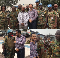 Majid Michel with the military men