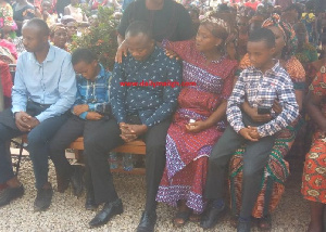 Late Ruth Eshun's husband and children at the Funeral