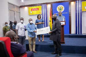 Zoomlion Ghana Limited has presented an amount of GHC100,000 to the COVI-19 National Trust Fund
