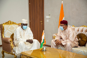 Nigeri president Mohamed Bazoum (right) meets AU chief Faki Mahamat in N'Djamena