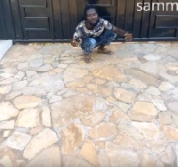 Ranking squatting in front of a house