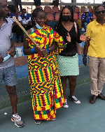 Grace Nyanyuie Tomegah with her award for winning the tourney