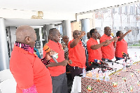 Dr Yaw Baah(second from right) and other executives chanting a solidarity song at the conference