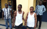The suspects in handcuffs
