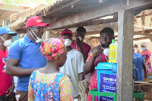 The team educating market women on how to properly wash hands