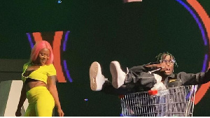 Kofi Mole appeared on stage in a shopping trolley