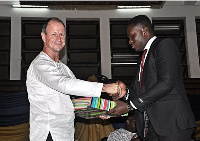 Eric Ametefe receiving his prize from ABL's Technical Director Vincent Oliver