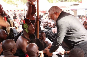 Former President Jerry John Rawlings in a handshake with Otumfuo