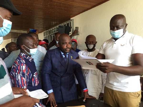 Mr Okyere Baafi presentidng his nomination forms  at the EC office