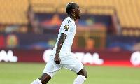 Guinea's Mohamed Yattara celebrates scoring their first goal