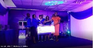 A retailer receiving her award