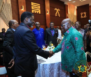 Bishop Charles Agyinasare in a handshake with Akufo-Addo