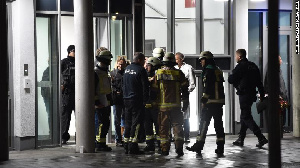 Firefighters and medical officers gather in front of the hospital where Richard Von was rushed to