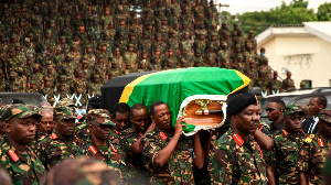 Tanzania People's Defence Force (TPDF) personnel carry the coffin of president John Magufuli in Dar