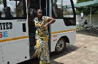 Matilda Amissah-Arthur posed by the donated bus