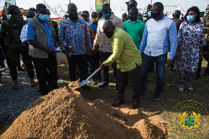 President Akufo-Addo cutting the sod for the construction of the road