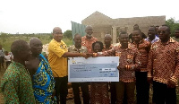 ICAG presented roofing materials worth GHC6,500 and a cheque of GHC5,000
