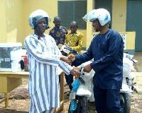 Braimah Wikana handing over the facility