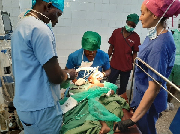 A team of Anaesthetists resuscitating a child after a major surgical operation
