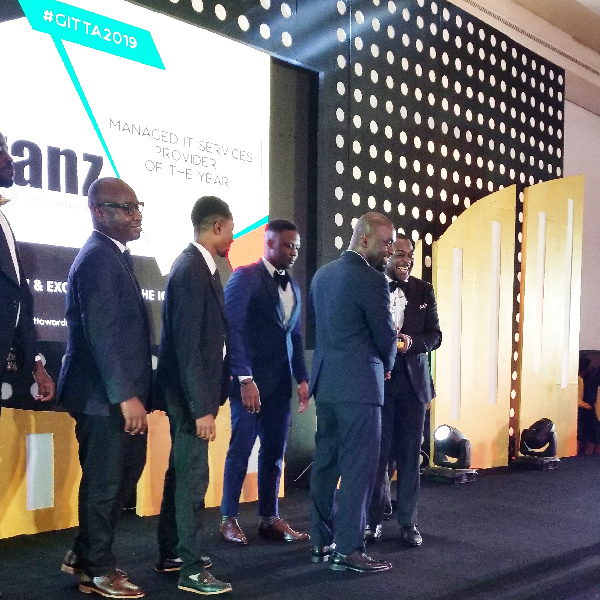 Liranz officials receiving an award for IT Services of the year