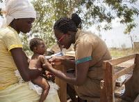 Community health nurse [R] discharging her duties