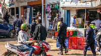 People prepare to close their shops for the day, in Kigali, PHOTO | CYRIL NDEGEYA | NMG