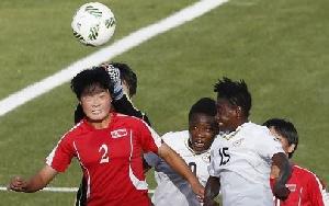 Jon Yun Sim of Korea DPR jumps for a header with Linda Amoako of Ghana.