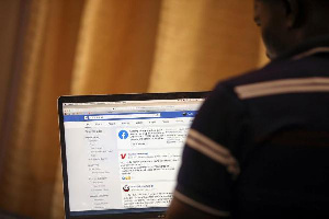 A man opens the Facebook page on his computer to fact check coronavirus disease, PHOTO | REUTERS