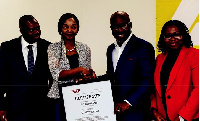 Odunfa, CEO, Digital Jewels presenting the ISO 27001 certificate to Frank Adu Jnr., MD of CalBank