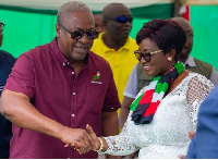 Maame Efua (L) shaking hands with former president Mahama