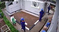 Screengrab of robbers disguised a utility sector workers