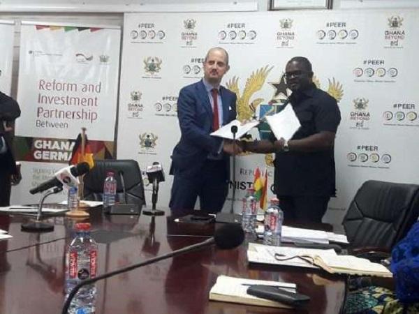 Deputy Minister of Finance, Charles Boahen and German Ambassador to Ghana Christoph Retzlaff