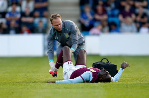 Albert Adomah injured during a match