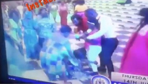 Church members bow down to touch Pastor Obinim