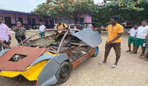 18-year-old JHS graduate, Kelvin Odartey with his manufactured car