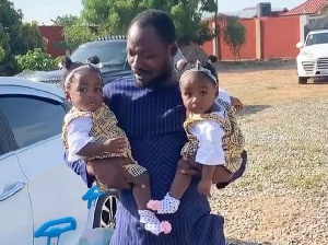 Comedian Funny Face and his twins