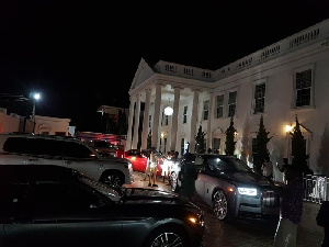 The new mansion and cars owned by Rev Obofour